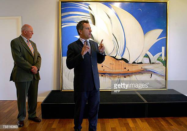 Justin Miller Sotheby's chairman with Ken Groves Qantas events and sponsorship manager speaks in front of Brett Whiteley's painting 'Opera House' in...