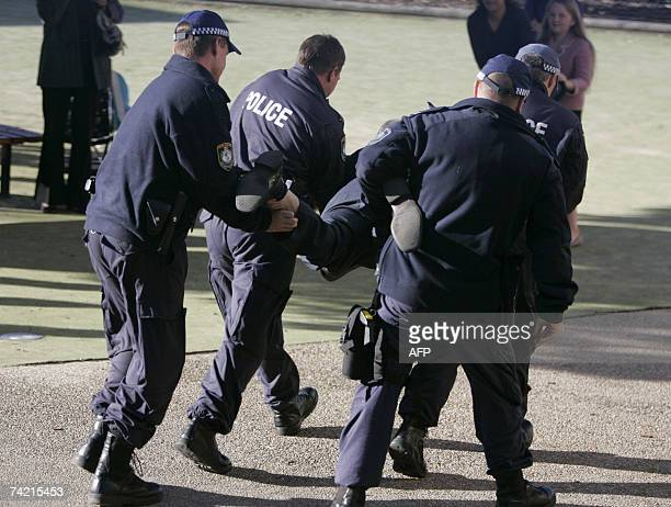 Police arrest a man during a visit by Greek Prime Minister Kostas Karamanlis at Saint Spyridon school in Sydney 22 May 2007 Karamanlis who is the...