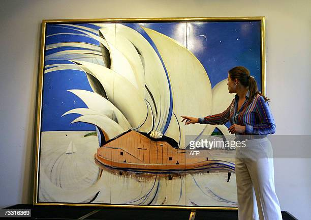Sotheby's head of Australian paintings Georgina Pemberton points out a feature on the Brett Whiteley painting 'Opera House' in Sydney 14 February...