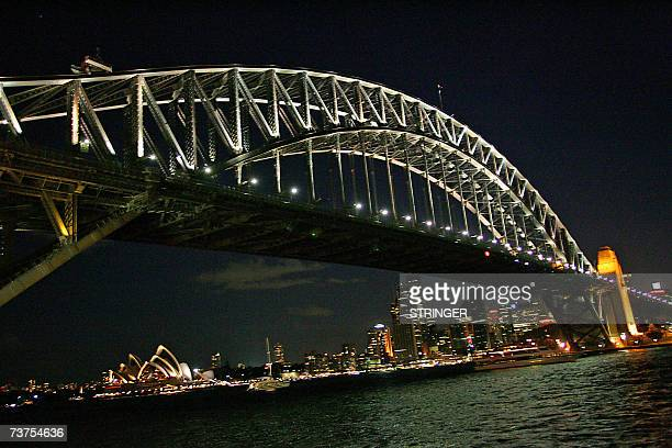 The lights along Sydney Harbour Bridge remain fully lit during the evening 31 March 2007 Australia's largest city was plunged into darkness for an...