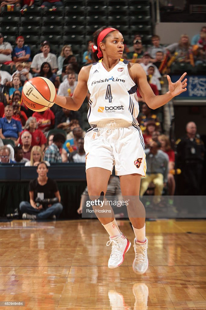 Sydney Carter #4 of the Indiana Fever moves the ball up-court against the Los Angeles Sparks on July 15, 2014 at Bankers Life Fieldhouse in Indianapolis, Indiana.