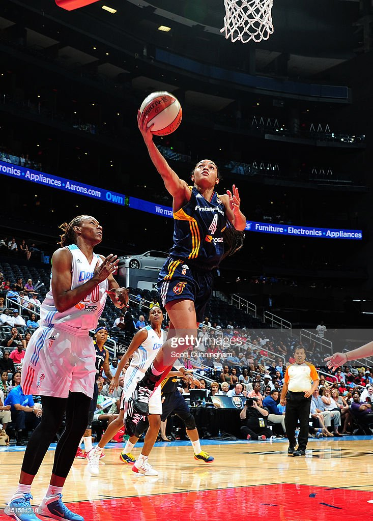 Sydney Carter #4 of the Indiana Fever puts up a shot against the Atlanta Dream on July 1, 2014 at Philips Arena in Atlanta, Georgia.
