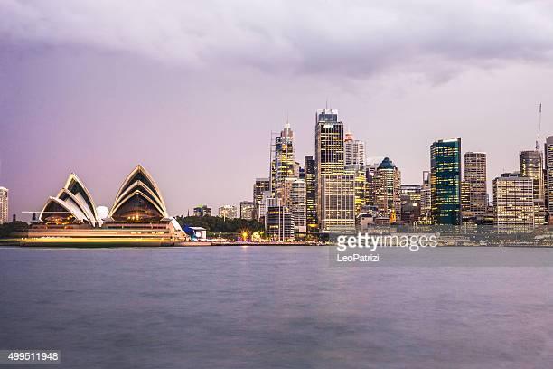 Sydney CBD and harbor illuminated at dusk