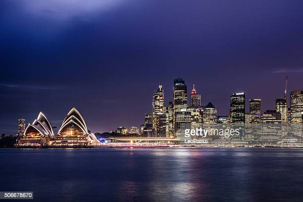Sydney CBD and harbor illuminated at night