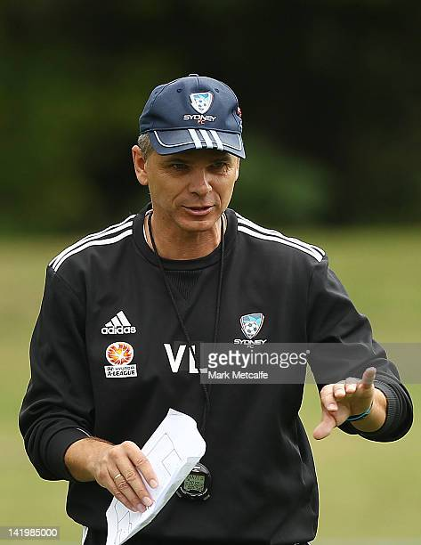 Sydney Coach Vitezslav Lavicka talks to players during a Sydney FC training session at Macquarie Uni on March 28 2012 in Sydney Australia