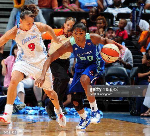 Sydney Colson of the New York Liberty drives against Coco Miller of the Atlanta Dream at Philips Arena on August 2 2011 in Atlanta Georgia NOTE TO...