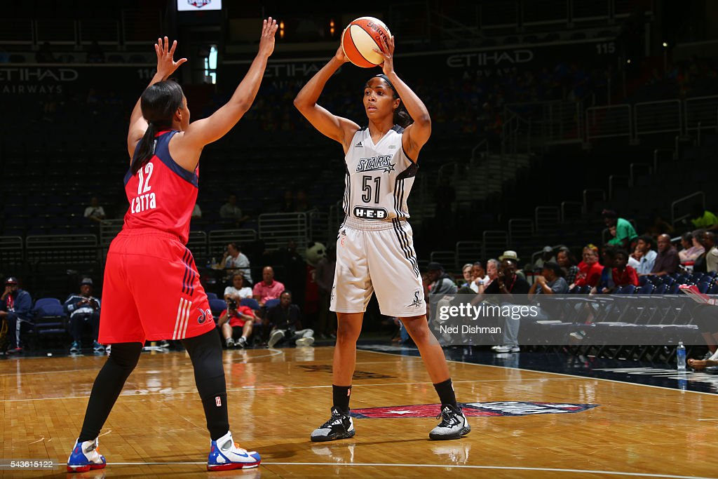 Sydney Colson #51 of the San Antonio Stars passes the ball against the Washington Mystics on June 29, 2016 at the Verizon Center in Washington, DC.
