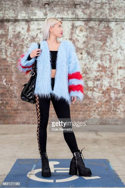 Sydney DJ Jade Le Flay wearing Isolated Hearts blue fur jacket and Fenty X Puma leggings during MercedesBenz Fashion Week Resort 18 Collections at...