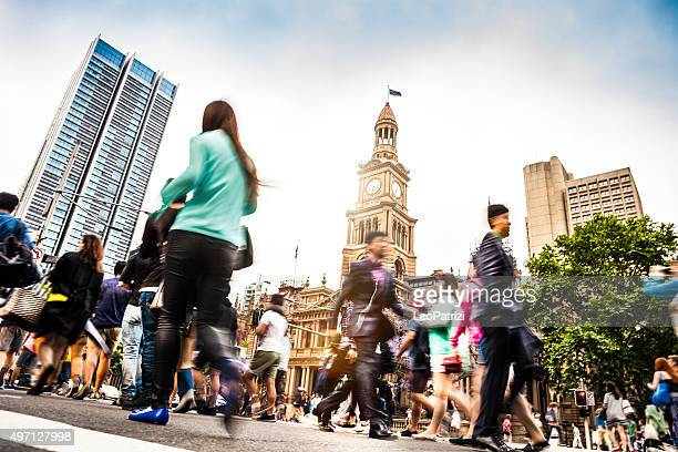 Sydney downtown, blurred intersection people and traffic