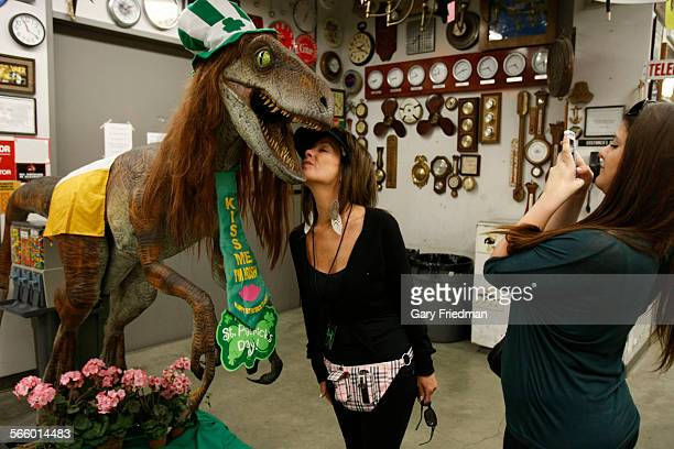 Sydney Edwards takes a photograph of her mother Marcy Edwards in the Edith Head Building on the Universal Studios Hollywood lot in Universal City on...