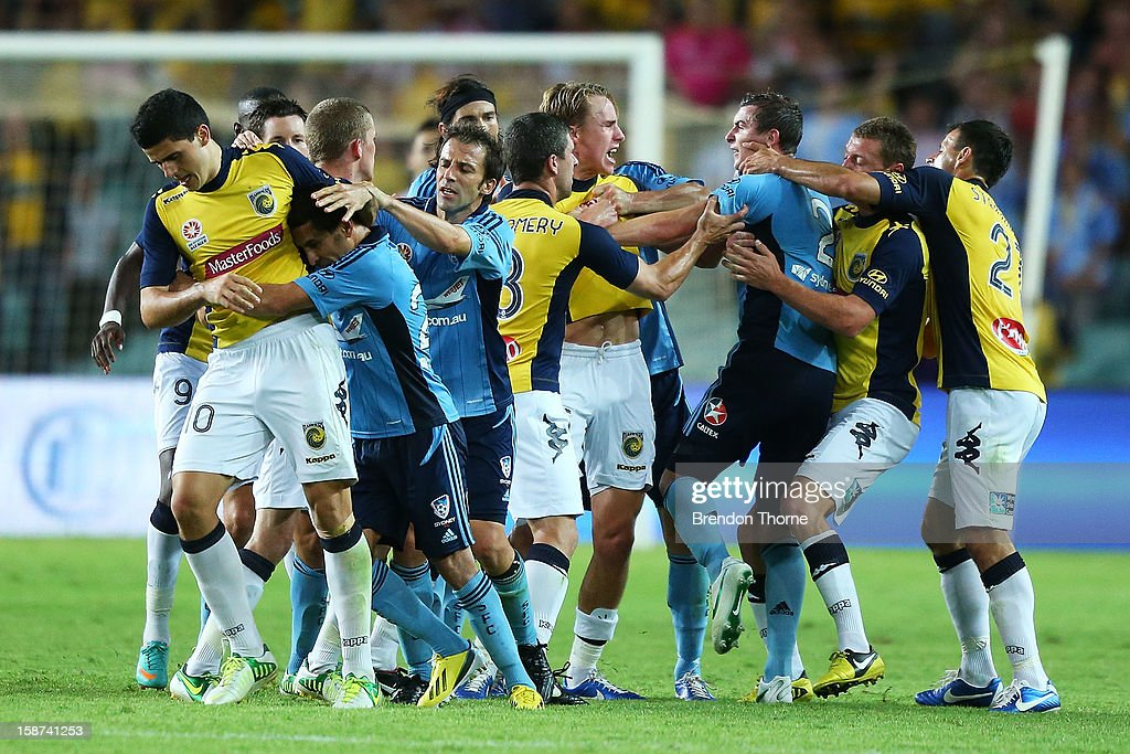 Sydney FC and Central Coast Mariners players jostle after a strong challenge between Rhyan Grant of Sydney and Tom Rogic of the Mariners during the round 13 A-League match between Sydney FC and the Central Coast Mariners at Allianz Stadium on December 27, 2012 in Sydney, Australia.