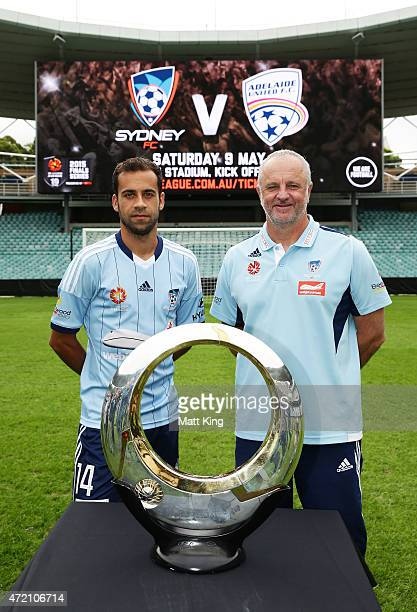 Sydney FC captain Alex Brosque and Sydney FC head coach Graham Arnold pose with the ALeague trophy during a Sydney FC ALeague Semi Final media...