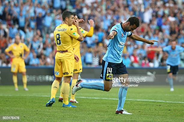 Sydney FC captain Alex Brosque celebrates scoring a goal during the round 12 ALeague match between Sydney FC and the Central Coast Mariners at...