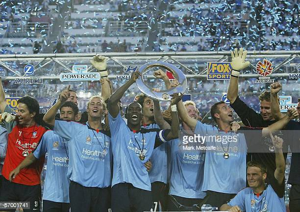 Sydney FC captain Dwight Yorke celebrates victory with teamates during the Hyundai ALeague Grand Final between Sydney FC and the Central Coast...