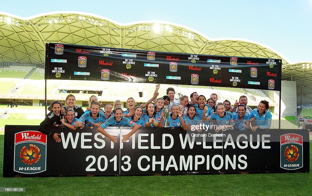 Sydney FC celebrate with the trophy after winning the W-League Grand Final between the Melbourne Victory and Sydney FC at AAMI Park on January 27, 2013 in Melbourne, Australia.
