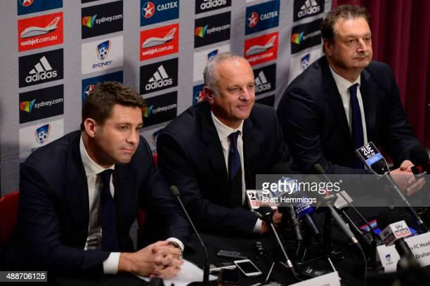 Sydney FC Chairman Scott Barlow Head Coach Graham Arnold and CEO Tony Pignata look on during the Sydney FC ALeague coach announcement at Allianz...