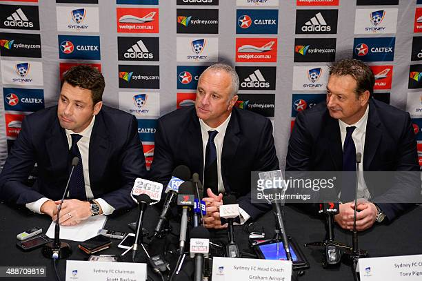 Sydney FC Chairman Scott Barlow Head Coach Graham Arnold and CEO Tony Pignata pose for a photo during the Sydney FC ALeague coach announcement at...