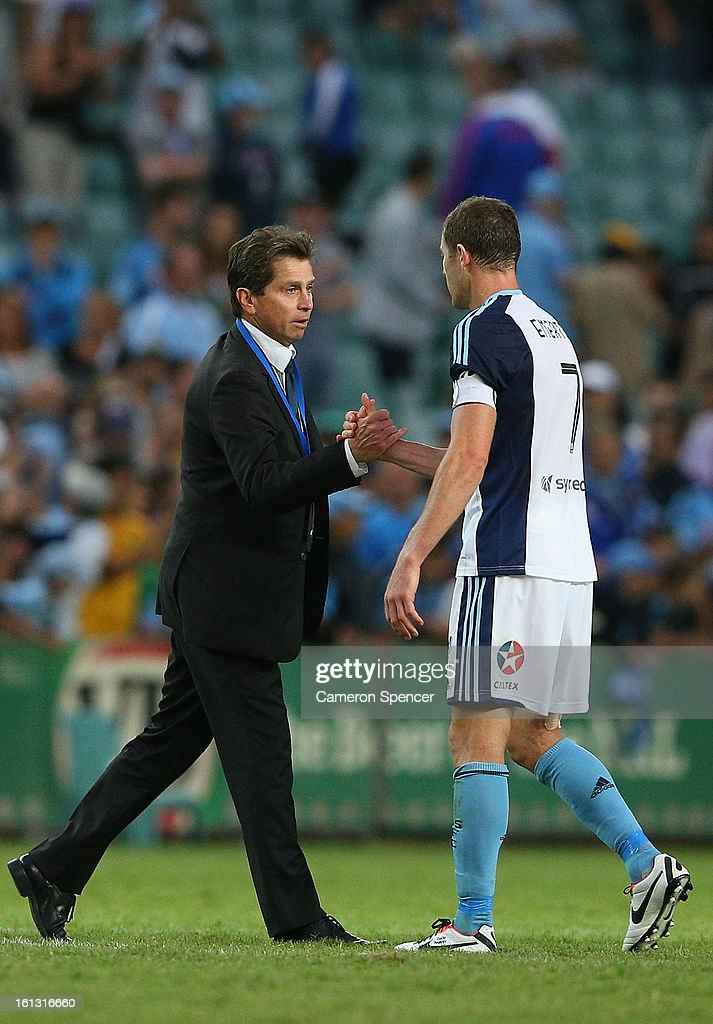 Sydney FC coach <a gi-track='captionPersonalityLinkClicked' href=/galleries/search?phrase=Frank+Farina&family=editorial&specificpeople=212825 ng-click='$event.stopPropagation()'>Frank Farina</a> shakes hands with captain <a gi-track='captionPersonalityLinkClicked' href=/galleries/search?phrase=Brett+Emerton&family=editorial&specificpeople=206493 ng-click='$event.stopPropagation()'>Brett Emerton</a> after winning the round 20 A-League match between Sydney FC and the Brisbane Roar at Allianz Stadium on February 10, 2013 in Sydney, Australia.