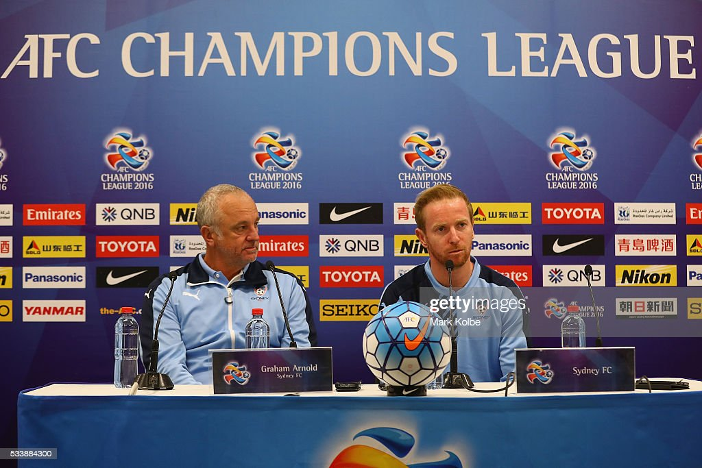 Sydney FC coach <a gi-track='captionPersonalityLinkClicked' href=/galleries/search?phrase=Graham+Arnold&family=editorial&specificpeople=545662 ng-click='$event.stopPropagation()'>Graham Arnold</a> and <a gi-track='captionPersonalityLinkClicked' href=/galleries/search?phrase=David+Carney+-+Voetballer&family=editorial&specificpeople=6991545 ng-click='$event.stopPropagation()'>David Carney</a> speak to the media during a Sydney FC press conference at the Sydney Cricket Groundg before a Sydney FC training session at Allianz Stadium on May 24, 2016 in Sydney, Australia.