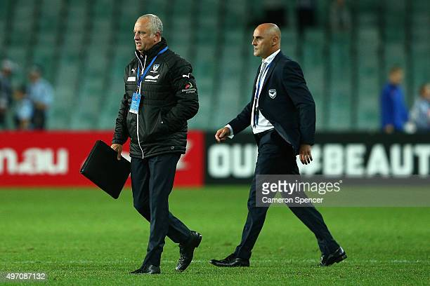 Sydney FC coach Graham Arnold and Victory coach Kevin Muscat walks onto the pitch following the round six ALeague match between Sydney FC and...