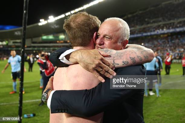 Sydney FC coach Graham Arnold celebrates with David Carney of Sydney at full time after Sydney FC win a penalty shoot out during the 2017 ALeague...