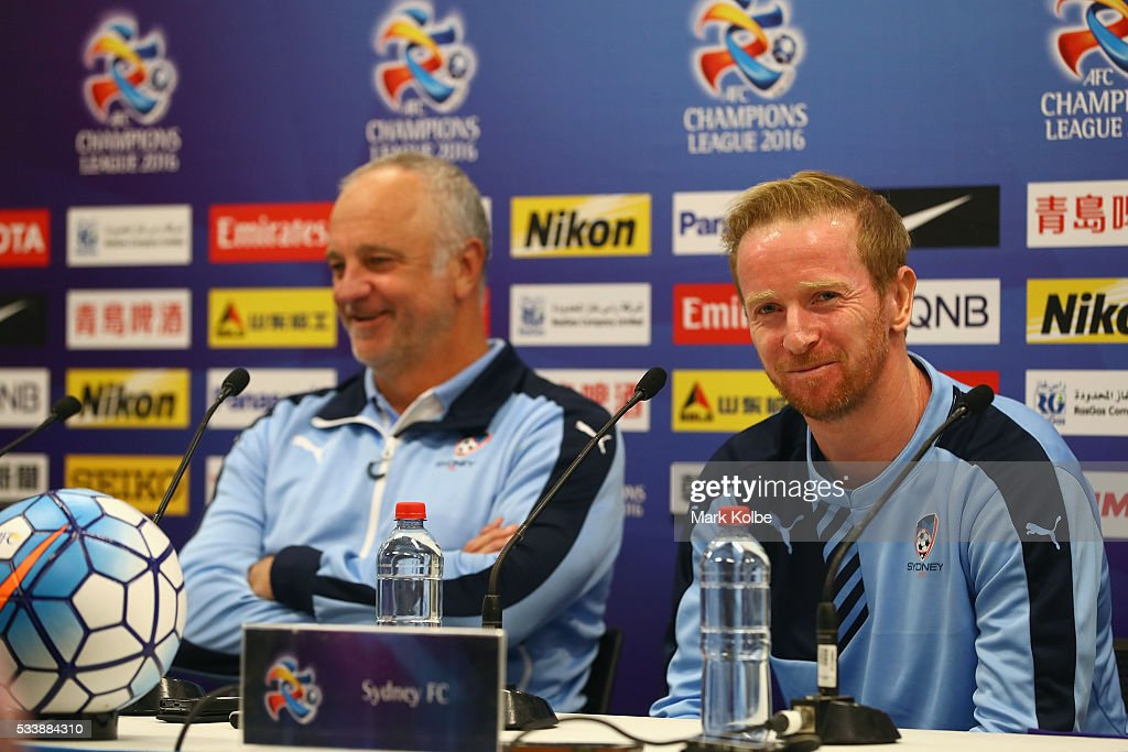 Sydney FC coach <a gi-track='captionPersonalityLinkClicked' href=/galleries/search?phrase=Graham+Arnold&family=editorial&specificpeople=545662 ng-click='$event.stopPropagation()'>Graham Arnold</a> laughs as <a gi-track='captionPersonalityLinkClicked' href=/galleries/search?phrase=David+Carney+-+Voetballer&family=editorial&specificpeople=6991545 ng-click='$event.stopPropagation()'>David Carney</a> speaks to the media during a Sydney FC press conference at the Sydney Cricket Groundg before a Sydney FC training session at Allianz Stadium on May 24, 2016 in Sydney, Australia.
