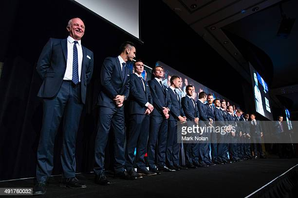 Sydney FC coach Graham Arnold lines up with his team during the Sydney FC ALeague season launch at The Westin hotel on October 8 2015 in Sydney...