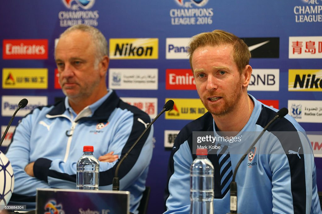 Sydney FC coach Graham Arnold looks on as David Carney speaks to the media during a Sydney FC press conference at the Sydney Cricket Groundg before a Sydney FC training session at Allianz Stadium on May 24, 2016 in Sydney, Australia.