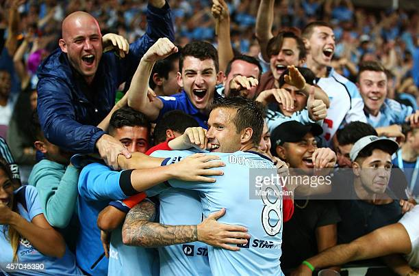 Sydney FC fans and players celebrate a goal by Corey Gameiro during the round one ALeague match between Sydney FC and Melbourne City at Allianz...