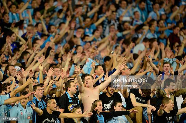 Sydney FC fans celebrate during the round two ALeague match between Sydney FC and the Western Sydney Wanderers at Allianz Stadium on October 18 2014...