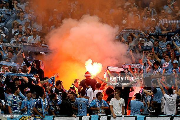 Sydney FC fans light flares during the round four ALeague match between the Central Coast Mariners and Sydney FC at Central Coast Stadium on October...