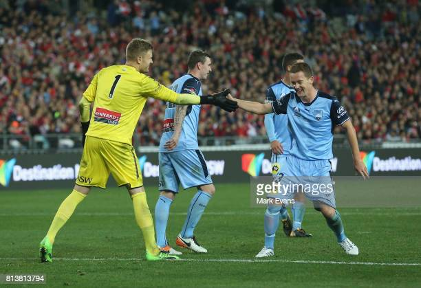Sydney FC goalkeeper Andrew Redmayne shakes the hand of Brandon O'Neill after he saved a penalty during the match between Sydney FC and Arsenal FC at...