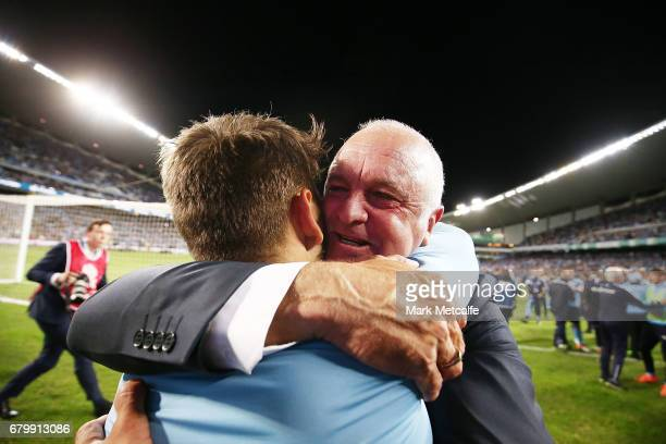 Sydney FC head coach Graham Arnold and Milos Ninkovic celebrate winning the 2017 ALeague Grand Final match between Sydney FC and the Melbourne...