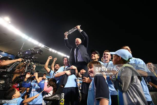 Sydney FC head coach Graham Arnold holds the trophy aloft after winning the 2017 ALeague Grand Final match between Sydney FC and the Melbourne...