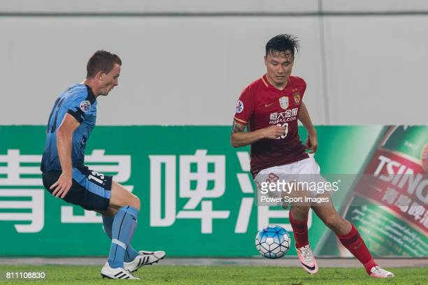 Sydney FC midfielder Brandon O'neill fights for the ball with Guangzhou Evergrande forward Gao Lin during the AFC Champions League 2016 Group Stage...