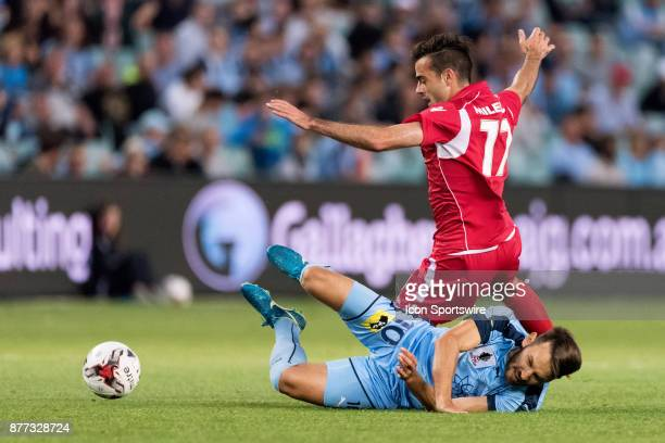 Sydney FC midfielder Milos Ninkovic and Adelaide United forward Nikola Mileusnic come together at the FFA Cup Final Soccer between Sydney FC and...