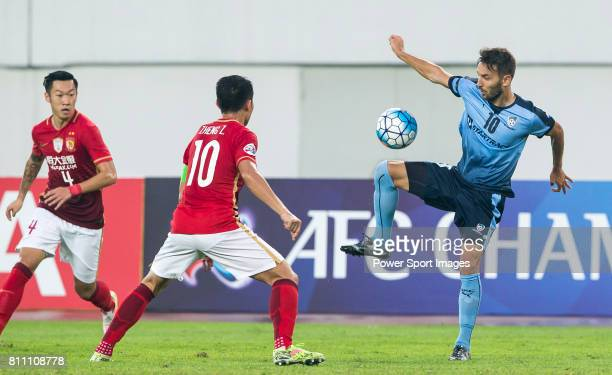 Sydney FC midfielder Milos Ninkovic fights for the ball with Guangzhou Evergrande midfielder Zheng Zhi during the AFC Champions League 2016 Group...