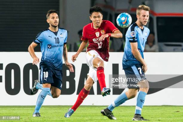 Sydney FC midfielder Milos Ninkovic Guangzhou Evergrande midfielder Wang Shangyuan and Sydney FC midfielder Andrew Hoole compete for the ball during...