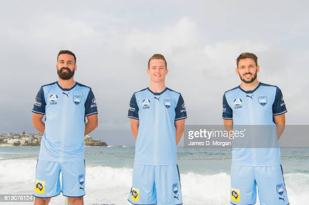 Sydney FC Players Alex Brosque Brandon O'Neill and Milos Ninkovic during the unveiling of the Sydney FC 2017/18 Hone Away Kit at Bondi Icebergs on...