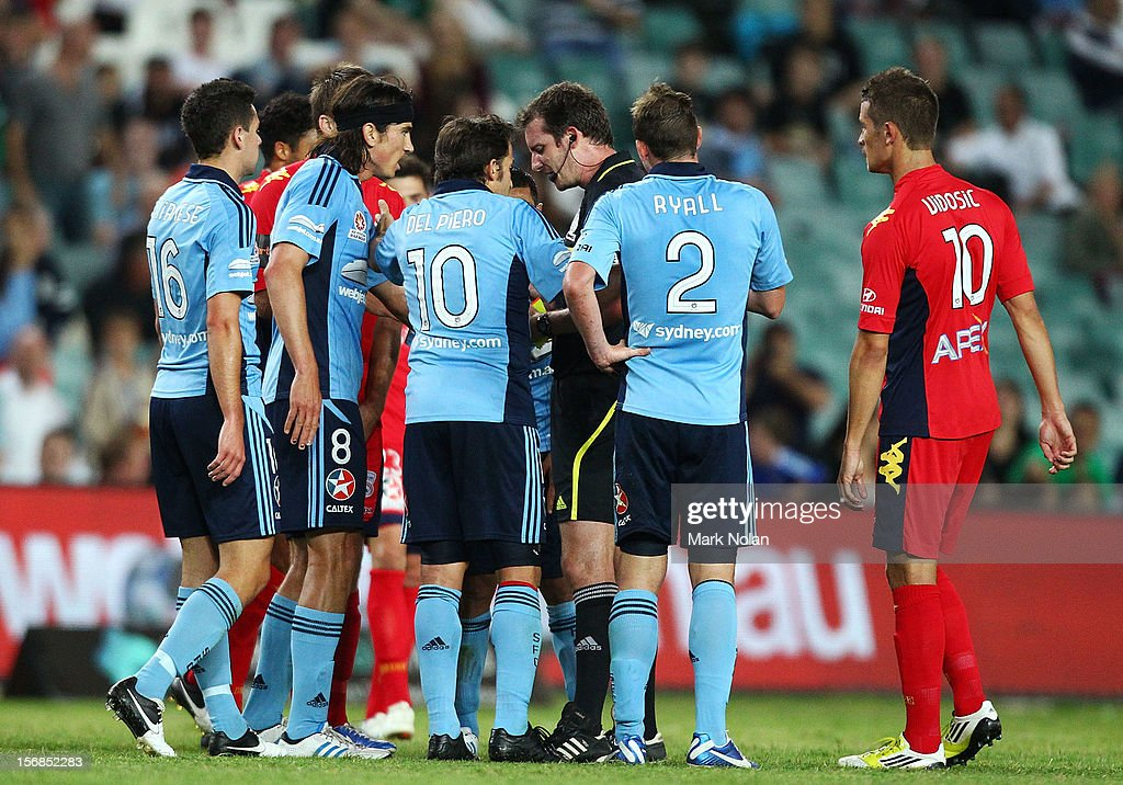 Sydney FC players argue with referee Peter Green during the round eight A-League match between Sydney FC and Adelaide United at Allianz Stadium on November 23, 2012 in Sydney, Australia.