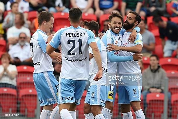 Sydney Fc players celebrate a goal during the round four ALeague match between the Newcastle jets and Sydney FC at McDonald Jones Stadium on October...