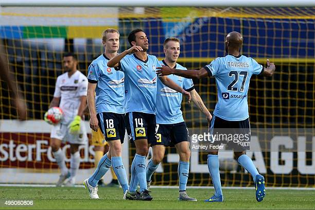 Sydney FC players celebrate a goal from Matthew Simon with Paul Izzo goalkeeper of the Mariners looking dejected in frame during the round four...