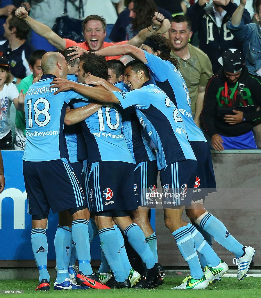 Sydney FC players celebrate after Brett Emerton opened the scoring for Sydney during the round 13 A-League match between Sydney FC and the Central Coast Mariners at Allianz Stadium on December 27, 2012 in Sydney, Australia.