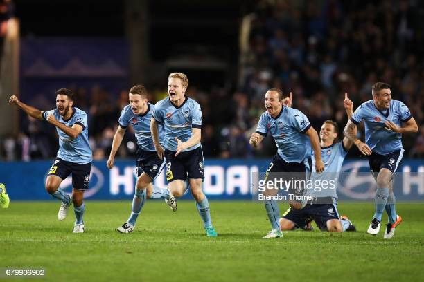 Sydney FC players celebrate after Milos Ninkovic of Sydney scores the winning penalty during the 2017 ALeague Grand Final match between Sydney FC and...
