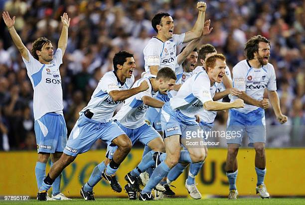 Sydney FC players celebrate after winning the penalty shootout for victory during the ALeague Grand Final match between the Melbourne Victory and...