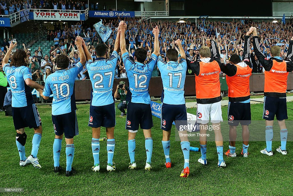 Sydney FC players celebrate with fans following the round 13 A-League match between Sydney FC and the Central Coast Mariners at Allianz Stadium on December 27, 2012 in Sydney, Australia.