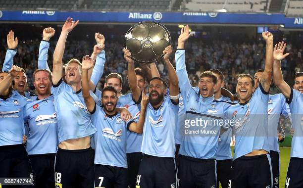 Sydney FC players celebrate with the Premiers Plate after the round 27 ALeague match between Sydney FC and the Newcastle Jets at Allianz Stadium on...