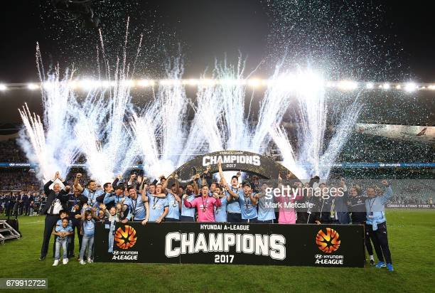 Sydney FC players celebrate with the trophy after winning the 2017 ALeague Grand Final match between Sydney FC and the Melbourne Victory at Allianz...