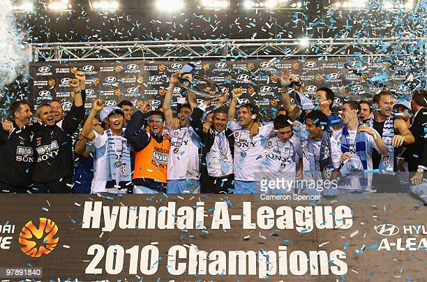 Sydney FC players celebrate with the trophy after winning the ALeague Grand Final match between the Melbourne Victory and Sydney FC at Etihad Stadium...