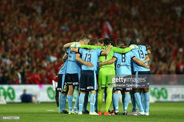Sydney FC players huddle during the round three ALeague match between Sydney FC and Western Sydney Wanderers at Allianz Stadium on October 24 2015 in...